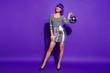 Leinwanddruck Bild - Full size photo of magnificent lady wearing eyeglasses eyewear holding mirror ball isolated over purple violet background