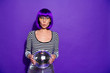 Leinwanddruck Bild - Portrait of impressed lady with eyewear eyeglasses holding mirror ball isolated over purple violet background