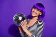 Leinwanddruck Bild - Close up photo of charming youth holding mirror ball smiling isolated over violet purple background
