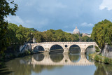 River Tiber and sisto bridge with St Peters in the distance Rome