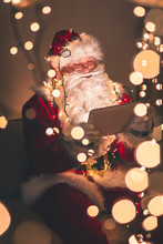 Santa Claus Using A Tablet Computer