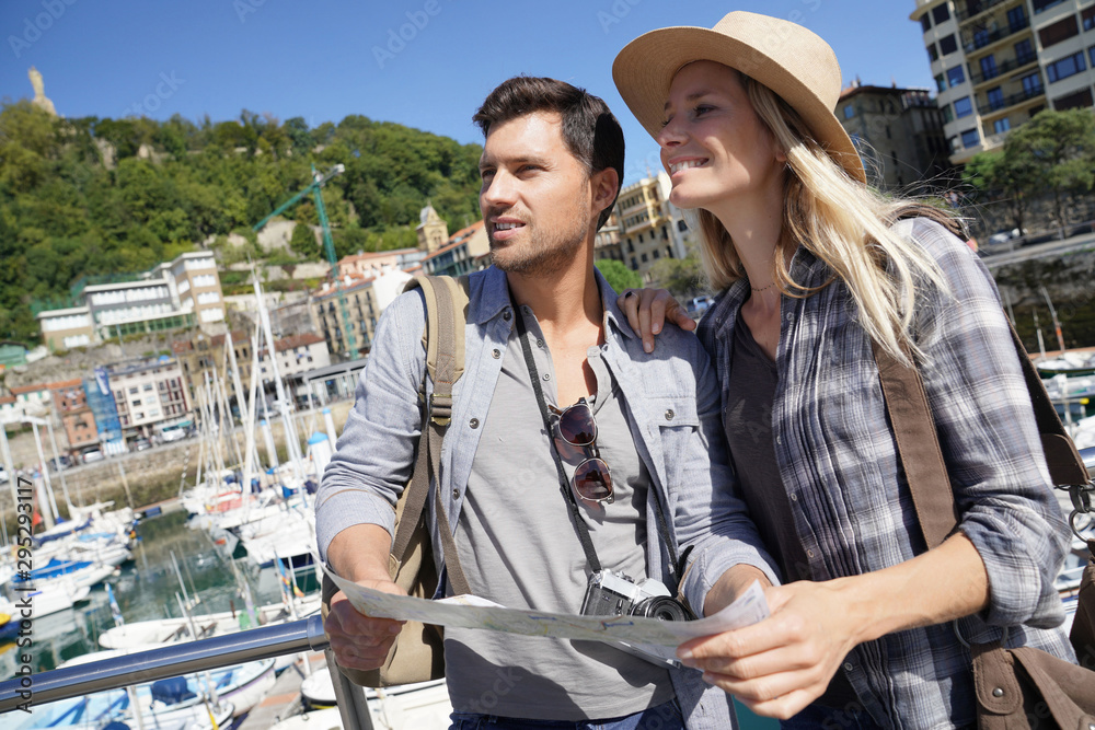 Fototapety, obrazy: Couple of tourists standing by marina