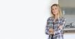 Leinwanddruck Bild - Attractive blond woman standing at home, copyspace