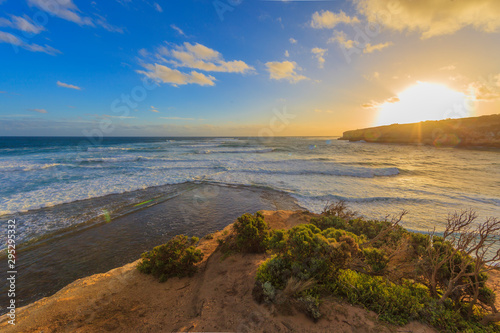 Fotobehang Natuur Picture of sunrise at the cliffy coast of Great Ocean Road in Southern Australia in summer 2015