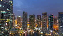 Residential And Office Buildings In Jumeirah Lake Towers District Day To Night Timelapse In Dubai