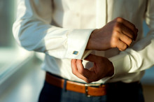 Сlose Up Of A Man In White Shirt And Cufflink. Man's Hands. Groom Photosession. Wedding Pictures.