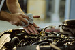Close up of a mechanic cleaning his hands after servicing a car in a workshop