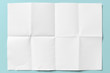 canvas print picture - White paper folded in eight, isolated on light blue