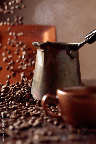 Keuken foto achterwand Cafe Falling coffee beans and old copper coffee maker.