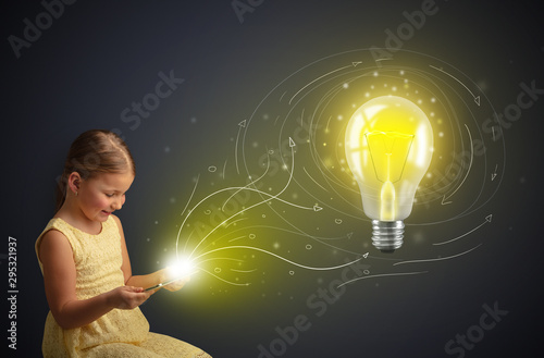Obraz Adorable girl working on tablet with new idea concept - fototapety do salonu