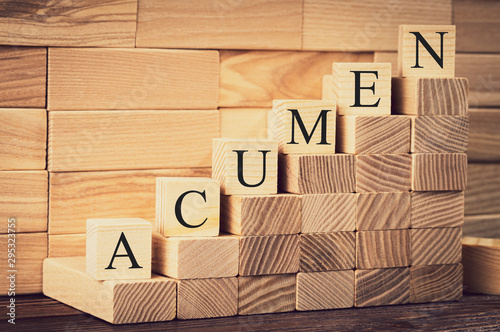 the word of acumen is made with building blocks on a wooden background, vignetti Wallpaper Mural
