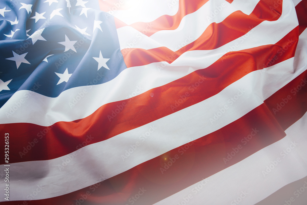 Fototapety, obrazy: Flag of the United States of America closeup. Symbol of freedom and democracy. Independence day. American flag waving in the wind.
