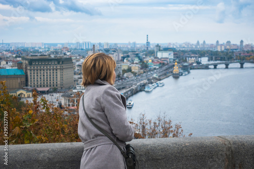 Fotografie, Tablou  A girl looks at Kiev from the observation deck