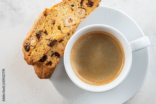 Slika na platnu Christmas homemade cookies biscotti with dry berries and cup of coffee