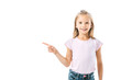 Leinwandbild Motiv positive and cute kid pointing with finger isolated on white