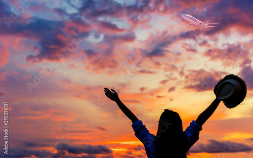 Foto auf Gartenposter Lachs Silhouette women recreation and freedom with sunset background. Young tourist in Thailand on summer holiday.