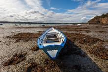 Saint Suliac Village, Brittany France. Docked Fishing Boat By Low Tide.