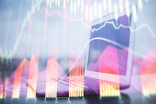 Fotomural  Forex Chart hologram on table with computer background