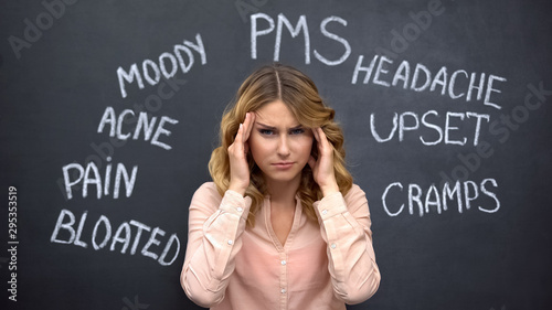 Obraz na plátne Woman suffering headache due to imaginary problems in pms, hormone imbalance