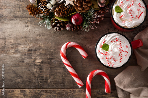 Fototapeta Peppermint coffee mocha decorated with candy canes for Christmas on wooden table