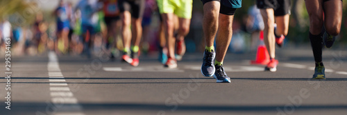 Fototapeta Marathon running race, people feet on city road obraz