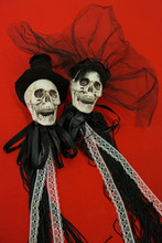 Bride And Groom Skull Wedding Dresses Symbol Of The Day Of The Dead And Hallowed, Typical American Party, With Red Background