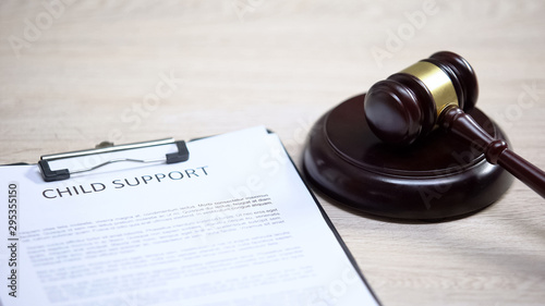 Child support document table, gavel lying on sound block, family law, court Canvas Print