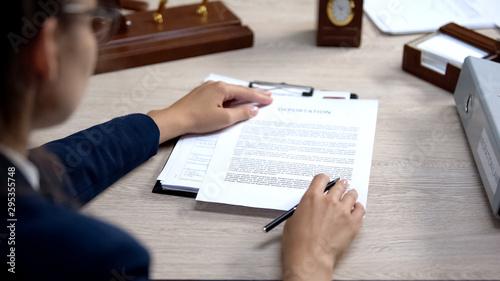 Obraz na plátně Employee looking through visa application, deportation document checking