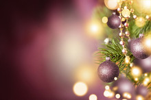 Fir Branch With Balls And Festive Lights On The Christmas Background With Sparkles.