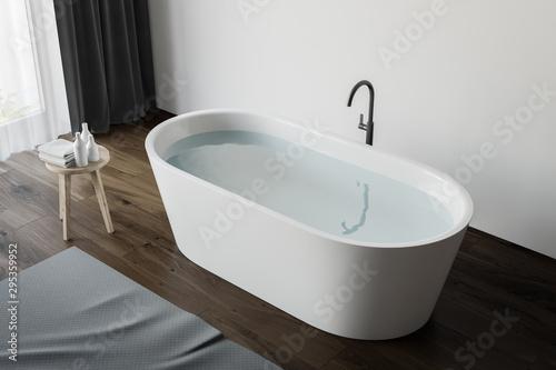 Top view of tub with water in wood floor bathroom Fototapet