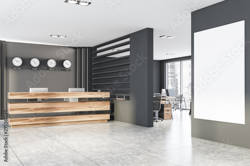 Grey office with clocks, reception and poster Wallpaper Mural