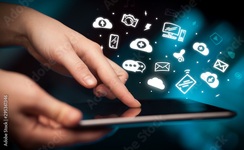 Hand holding tablet with social media concept - 295361346