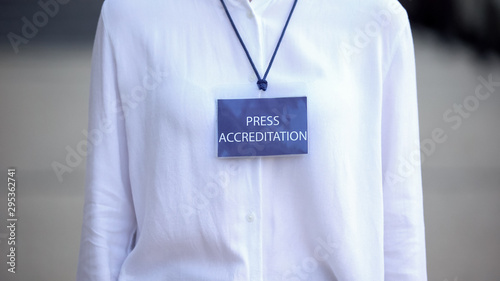 Close-up of female with press accreditation badge, journalist event pass, access Canvas Print