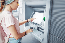 Asian Woman Withdraws Money And Pays The Credit For Study At The Street European ATM Self-service Macine
