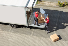 Male Movers Unloading The Card...