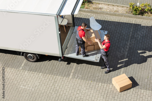 Male Movers Unloading The Cardboard Boxes Form Truck Fototapet