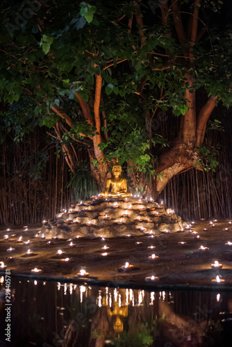 Montage in der Fensternische Nordlicht Candle Light with Buddha Statue at Wat Pan Tao Temple with beautiful water reflection in Phan Tao Temple, Chiangmai, Thailand