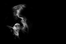 Powder-shaped Ghost On Black Background.