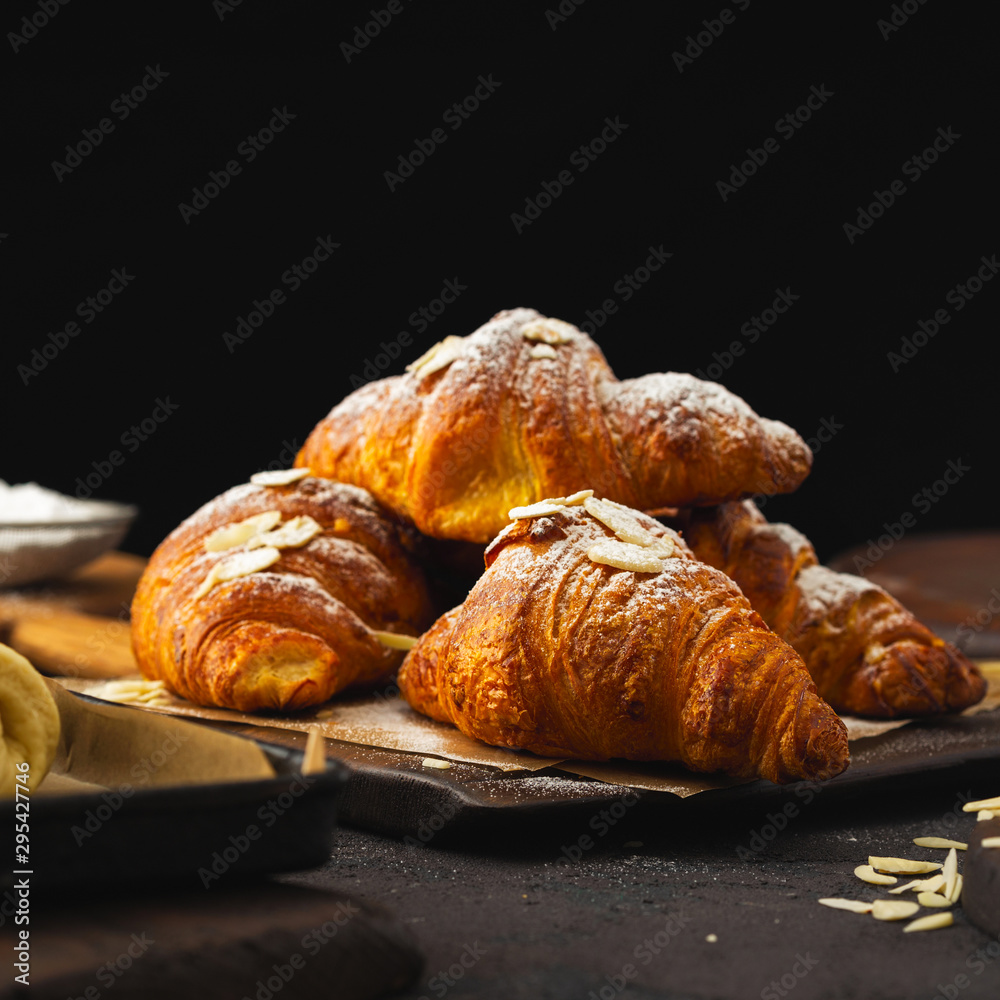 Fototapety, obrazy: Breakfast croissant with chocolate on a dark stone background