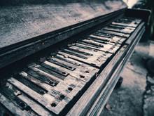 Old Broken Piano In Ruins.