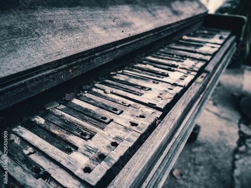 Old broken piano in ruins. - 295436909