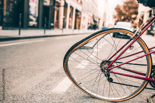 Damaged bicycle with a bent wheel during a road accident collision Canvas Print