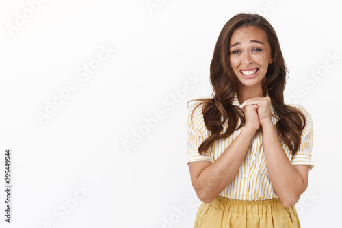 Happy excited young cute woman feeling grateful and proud, press hands together Wallpaper Mural