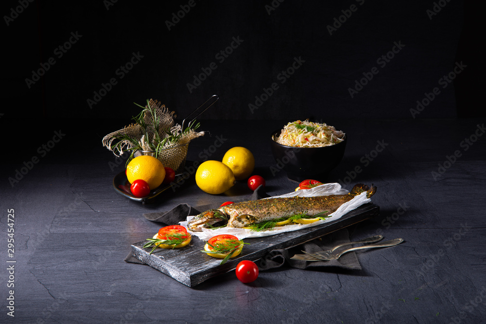 Fototapety, obrazy: baked trout with herb filling and tomatoes