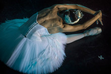 "A Prima Ballerina In The Role Of ""Odette"" In The Scene Of The Ballet ""Swan Lake"" Performs At The Theater Stage"