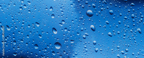 Fotografia banner for website Water drop on the glass of windows background, raining on the glass off window city for background