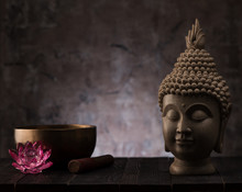 Buddha Head Statue And Singing Bowl