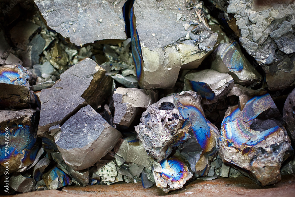 Fototapeta Pieces of ferrotitanium closeup. Ferroalloy used for alloying, deoxidation and degassing of steels and alloys