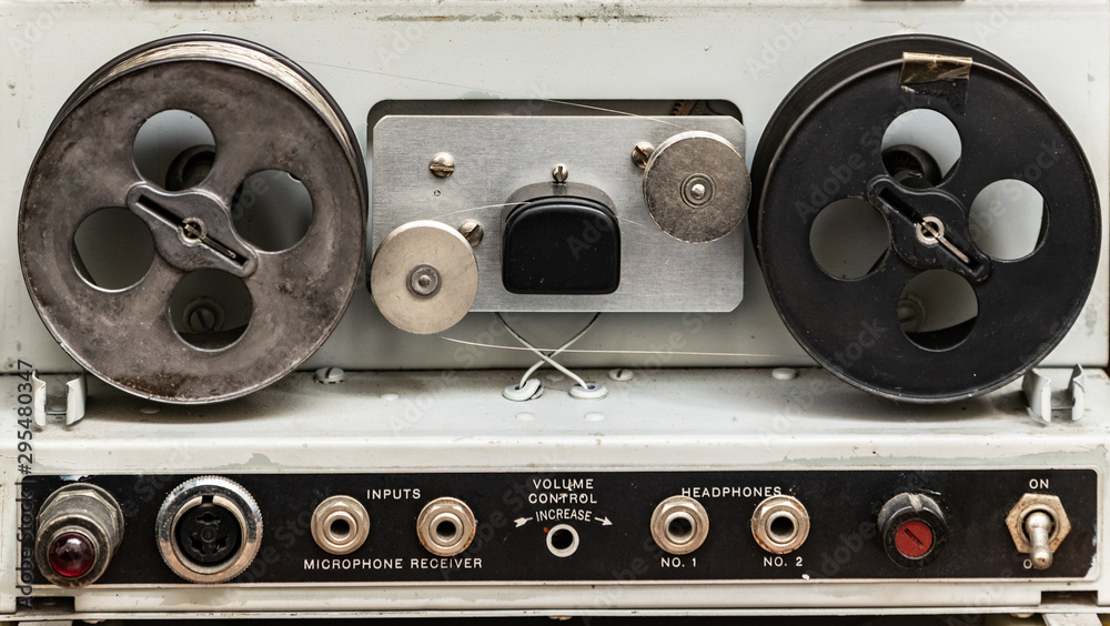 Fototapety, obrazy: Close up on vintage reel to reel magnetic tape machine from the 1940s