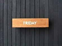 Wooden Sign Friday On A Black ...